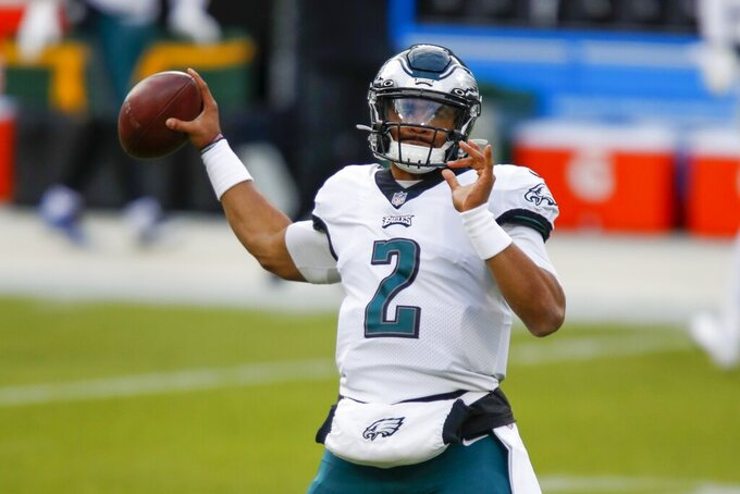 Philadelphia Eagles' Jalen Hurts warms up before an NFL football game against the Green Bay Packers Sunday, Dec. 6, 2020, in Green Bay, Wis. (AP Photo/Matt Ludtke)