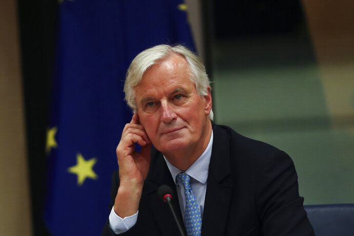 European Union chief Brexit negotiator Michel Barnier arrives to a Brexit Steering Group meeting at the European Parliament in Brussels, Wednesday, Oct. 16, 2019. (AP Photo/Francisco Seco)