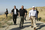 FILE - in this Sunday, June 23, 2019 file photo, US National Security Advisor John Bolton, right, and Israeli Prime Minister Benjamin Netanyahu, visit an old army outpost overlooking the Jordan Valley between the Israeli city of Beit Shean and the Palestinian city of Jericho. Netanyahu vowed Tuesday, September 10, 2019 to begin annexing West Bank settlements if he wins national elections next week. (AP Photo/Abir Sultan, File)