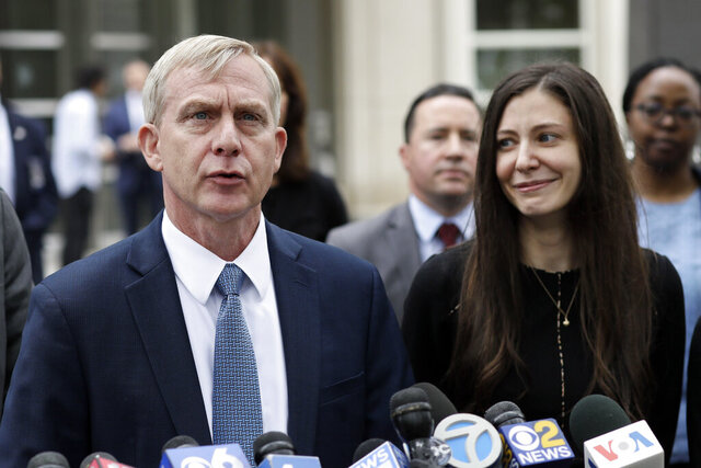 FILE - This June 19, 2019 file photo shows U.S. Attorney Richard Donoghue, left, talking to the media with prosecutor Moira Penza outside Brooklyn federal court after NXIVM defendant Keith Raniere was found guilty on all counts, in New York. A judge has set an Oct. 27, 2020 sentencing date for Raniere, leader of an upstate New York self-improvement group who was convicted last year on charges that he turned some of followers into sex slaves. (AP Photo/Mark Lennihan, File)