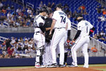 Miami Marlins starting pitcher Zach Thompson (74) talks with catcher Alex Jackson (23) and pitching coach Mel Stottlemyre, center, with the bases loaded during the second inning of a baseball game against the New York Mets, Wednesday, Aug. 4, 2021, in Miami. (AP Photo/Lynne Sladky)