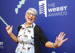 FILE - This May 13, 2019 file photo shows Lisa Lampanelli at the 23rd annual Webby Awards in New York.  Fairfield police say they responded to Lampanelli's home Friday by her sister who said she had received a phone call from a woman claiming to be Lampanelli. The woman said she was at her house but was locked out. Police say the real Lisa Lampanelli was out of state at the time. Officers found 56-year-old Anna Dominguez, of Lancaster, Pennsylvania in a car in the driveway. Dominguez was held on $500 bond after a court appearance Monday, Oct. 7, on an attempted burglary charge. (Photo by Christopher Smith/Invision/AP, File)
