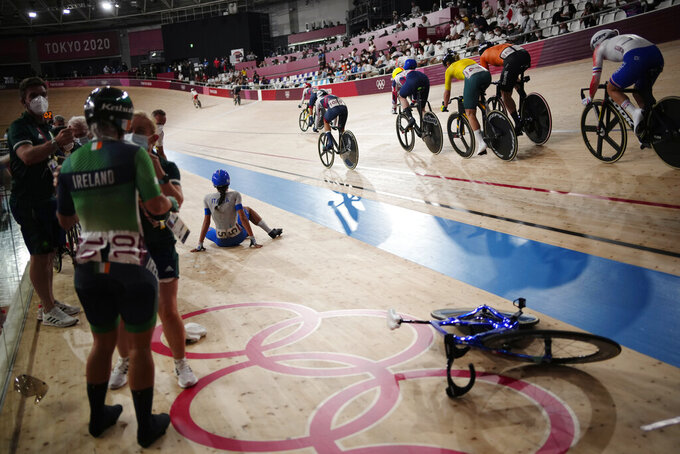 Athletes compete during the track cycling women's madison race at the 2020 Summer Olympics, Friday, Aug. 6, 2021, in Izu, Japan. (AP Photo/Christophe Ena)