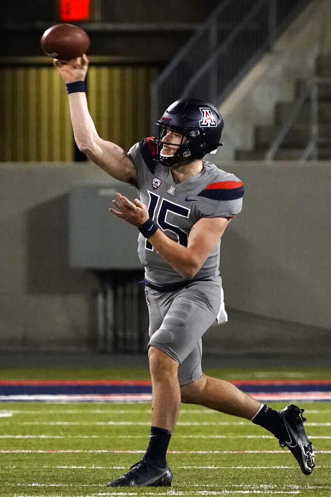 Arizona quarterback Will Plummer (15) throws down field against Colorado in the second half during an NCAA college football game, Saturday, Dec. 5, 2020, in Tucson, Ariz. Colorado won 24-13. (AP Photo/Rick Scuteri)