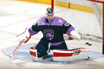 Florida Panthers goaltender Chris Driedger warms up for the team's NHL hockey game against the Carolina Hurricanes, Saturday, April 24, 2021, in Sunrise, Fla. (AP Photo/Joel Auerbach)