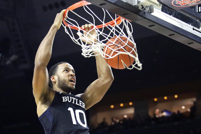 Butler forward Bryce Nze dunks during the first half of the team's NCAA college basketball game against Providence, Friday, Jan. 10, 2020, in Providence, R.I. (AP Photo/Elise Amendola)