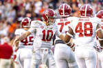 Alabama quarterback Mac Jones (10) greets teammates after an extra point against Auburn during the first half of an NCAA college football game, Saturday, Nov. 30, 2019, in Auburn, Ala. (AP Photo/Vasha Hunt)