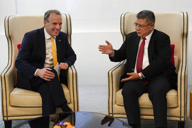 Malaysian Foreign Minister Saifuddin Abdullah, right, talks with Britain's Foreign Secretary Dominic Raab at Foreign Ministry in Putrajaya, Malaysia, Tuesday, Feb. 11, 2020. (AP Photo/Vincent Thian)