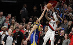 Portland Trail Blazers guard Damian Lillard, right, shoots under pressure from Golden State Warriors guard Klay Thompson, left, in the final seconds of overtime in of Game 4 of the NBA basketball playoffs Western Conference finals against the Golden State Warriors, Monday, May 20, 2019, in Portland, Ore. The shot fell short and the Warriors won 119-117 in overtime. (AP Photo/Ted S. Warren)