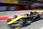Renault driver Daniel Ricciardo of Australia drives in the pit lane during a Formula One pre-season testing session at the Catalunya racetrack in Montmelo, outside Barcelona, Spain, Tuesday, Feb. 26, 2019. (AP Photo/Joan Monfort)