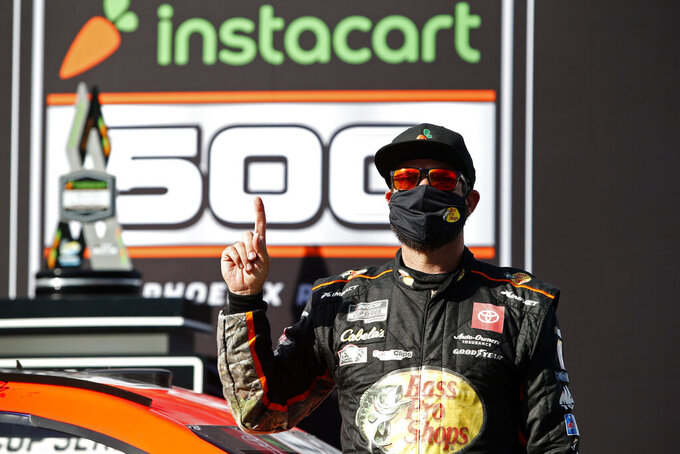 Martin Truex Jr. celebrates in Victory Lane after winning a NASCAR Cup Series auto race at Phoenix Raceway, Sunday, March 14, 2021, in Avondale, Ariz. (AP Photo/Ralph Freso)