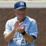 FILE - In this June 9, 2018, file photo, North Carolina coach Mike Fox encourages his players during an NCAA super regional college baseball game against Stetson, in Chapel Hill, N.C. North Carolina's offense is rolling along as the Tar Heels return to the College World Series for the first time since 2013. (AP Photo/Gerry Broome, File)