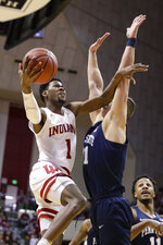 Indiana guard Al Durham (1) shoots over Penn State forward John Harrar (21) in the first half of an NCAA college basketball game in Bloomington, Ind., Sunday, Feb. 23, 2020. (AP Photo/Michael Conroy)