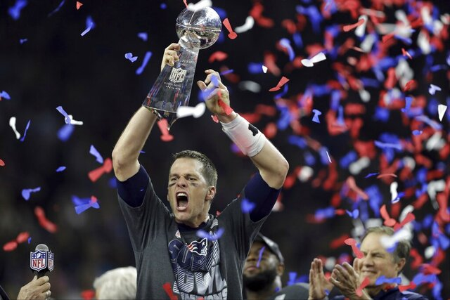 "FILE - In this Feb. 5, 2017, file photo, New England Patriots' Tom Brady raises the Vince Lombardi Trophy after defeating the Atlanta Falcons in overtime at the NFL Super Bowl 51 football game in Houston. Brady's journey to each of his nine Super Bowls with the New England Patriots will be the subject of an ESPN series released in 2021. Entitled ""The Man in the Arena: Tom Brady,"" the nine-episode series will include a look from Brady's perspective at the six NFL titles and three Super Bowl defeats he was a part of. (AP Photo/Darron Cummings, File)"