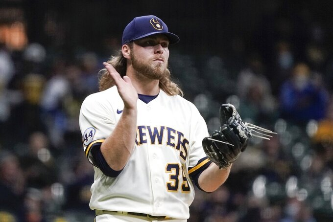 Milwaukee Brewers' Corbin Burnes reacts after getting Miami Marlins' Sandy Leon to strike out during the fifth inning of a baseball game Monday, April 26, 2021, in Milwaukee. (AP Photo/Morry Gash)