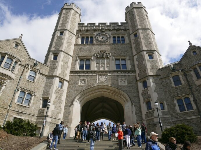 FILE - In this April 5, 2018, file photo, people walk through the Princeton University campus in Princeton, N.J. The Trump administration has opened an investigation into racial bias at Princeton University, Wednesday, Sept. 16, 2020, saying that the school's recent acknowledgment of racism on campus amounts to a