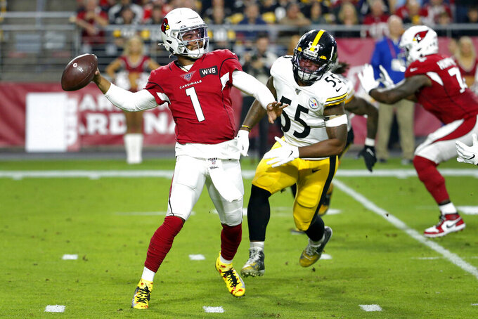 Arizona Cardinals quarterback Kyler Murray (1) throws as Pittsburgh Steelers linebacker Devin Bush pursues during the first half of an NFL football game, Sunday, Dec. 8, 2019, in Glendale, Ariz. (AP Photo/Rick Scuteri)