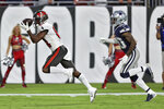 Tampa Bay Buccaneers wide receiver Antonio Brown (81) pulls in a touchdown reception iafter getting around Dallas Cowboys cornerback Anthony Brown (30) during the first half of an NFL football game Thursday, Sept. 9, 2021, in Tampa, Fla. (AP Photo/Mark LoMoglio)