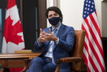 Canadian Prime Minister Justin Trudeau is seen as he speaks virtually with United States President Joe Biden from his office on Parliament Hill in Ottawa, Ontario, Tuesday, Feb. 23, 2021. (Adrian Wyld/The Canadian Press via AP)