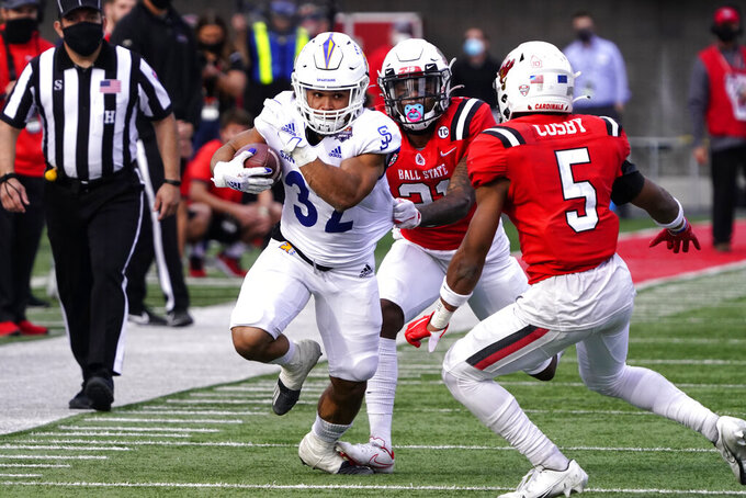 San Jose State running back Kairee Robinson (32) runs for a first down against Ball State during the second half of the Arizona Bowl NCAA college football game Thursday, Dec. 31, 2020, in Tucson, Ariz. Ball State won 34-13. (AP Photo/Rick Scuteri)