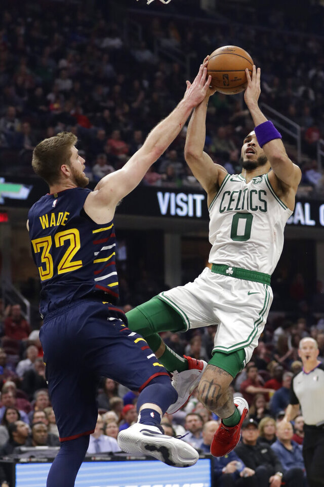 Boston Celtics' Jayson Tatum (0) drives to the basket against Cleveland Cavaliers' Dean Wade (32) in the first half of an NBA basketball game, Wednesday, March 4, 2020, in Cleveland. (AP Photo/Tony Dejak)