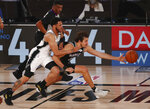 San Antonio Spurs guard Quinndary Weatherspoon (15) and Sacramento Kings forward Nemanja Bjelica (88) go after the ball in the second half of an NBA basketball game Friday, July 31, 2020, in Lake Buena Vista, Fla. (Kim Klement/Pool Photo via AP)