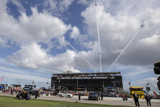 The Thunderbirds flyover as President Donald Trump, accompanied by first lady Melania Trump, stands during the national anthem before the start of the NASCAR Daytona 500 auto race at Daytona International Speedway, Sunday, Feb. 16, 2020, in Daytona Beach, Fla. (AP Photo/Alex Brandon)