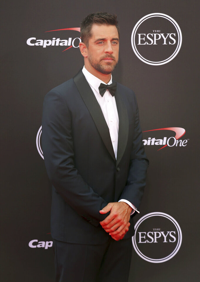 """File-This July 18, 2018, file photo shows Green Bay Packers quarterback Aaron Rodgers arriving at the ESPY Awards in Los Angeles.  Rodgers got quite the surprise in his first episode as a guest host of """"Jeopardy!"""" Contestant Scott Shewfelt was stumped on the final question of the episode that aired Monday, April 5, 2021, and decided to reply by referencing a controversial Packers strategic decision in last season's NFC championship game as he wrote, """"Who wanted to kick that field goal?"""" (Photo by Willy Sanjuan/Invision/AP, File)"""