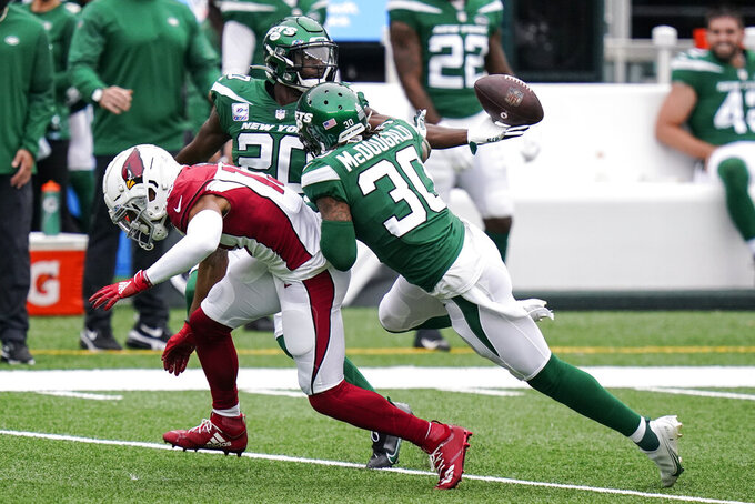 New York Jets free safety Marcus Maye (20) breaks up a pass to Arizona Cardinals wide receiver Christian Kirk (13) during the first half of an NFL football game, Sunday, Oct. 11, 2020, in East Rutherford. (AP Photo/Frank Franklin II)