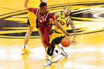 Missouri's Xavier Pinson, right, is fouled by Arkansas' Jalen Tate, left, during the second half of an NCAA college basketball game Saturday, Feb. 13, 2021, in Columbia, Mo. (AP Photo/L.G. Patterson)