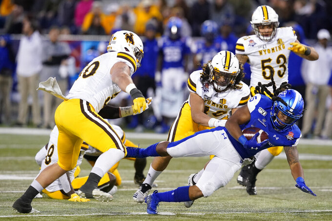 Georgia State running back Tra Barnett (5) dives for a first down against Wyoming during the second half of the Arizona Bowl NCAA college football game Tuesday, Dec. 31, 2019, in Tucson, Ariz. (AP Photo/Rick Scuteri)