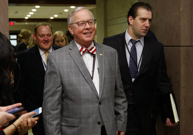 """FILE - U.S. Rep. Ron Wright, R-Texas, walks to a session during member-elect briefings and orientation on Capitol Hill in Washington, Thursday, Nov. 15, 2018.  Wright was admitted to a Dallas hospital due to complications surrounding his cancer treatment, his campaign said Monday, Sept. 14, 2020.  Wright, 67-year-old Republican, was elected in 2018 to Texas' 6th congressional district in Arlington. His campaign said in a statement that Wright has """"been in a tough battle with cancer this year."""" (AP Photo/Carolyn Kaster)"""
