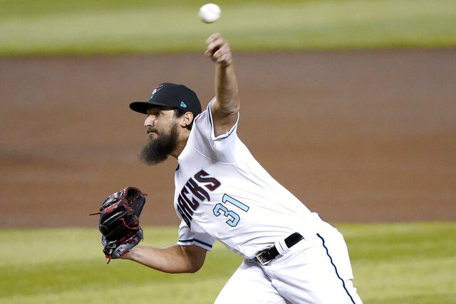 Arizona Diamondbacks starting pitcher Caleb Smith (31) throws against the Seattle Mariners during the first inning of a baseball game, Friday, Sept. 11, 2020, in Phoenix. AP Photo/Matt York)