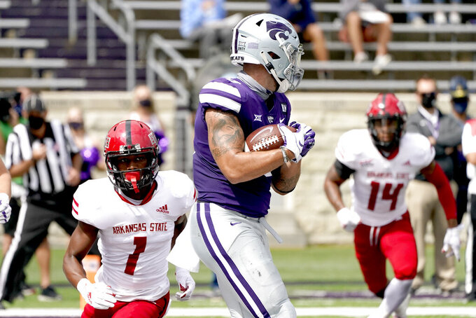 Kansas State tight end Briley Moore (0) catches a pass in the end zone to score a touchdown during the first half of an NCAA college football game against Arkansas State Saturday, Sept. 12, 2020, in Manhattan, Kan. (AP Photo/Charlie Riedel)