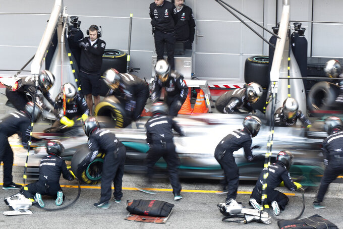Mercedes-AMG Petronas' Lewis Hamilton makes a pit stop during a Formula One pre-season testing session at the Barcelona Catalunya racetrack in Montmelo, outside Barcelona, Spain, Thursday, Feb. 20, 2020. (AP Photo/Joan Monfort)