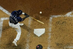 Tampa Bay Rays' Randy Arozarena hits a home run against the Los Angeles Dodgers during the fourth inning in Game 4 of the baseball World Series Saturday, Oct. 24, 2020, in Arlington, Texas. (AP Photo/David J. Phillip)