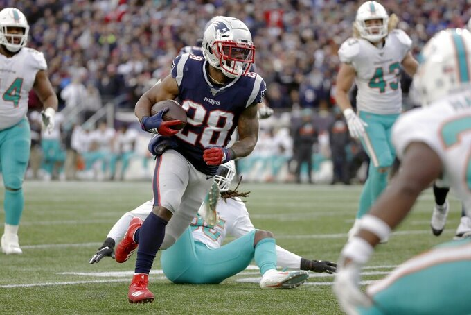 New England Patriots running back James White runs past Miami Dolphins safety Walt Aikens, rear, on his way to a touchdown in the second half of an NFL football game, Sunday, Dec. 29, 2019, in Foxborough, Mass. (AP Photo/Elise Amendola)