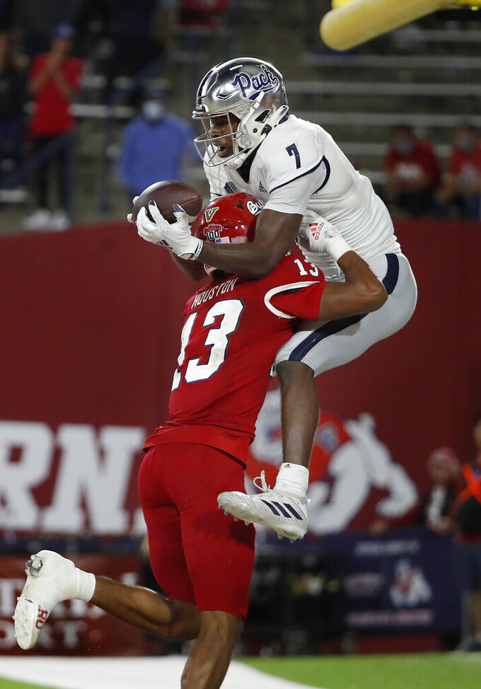 Nevada wide receiver Romeo Doubs catches a two-point conversion-try as he is pushed out of bounds by Fresno State defensive back Justin Houston to end the second half of an NCAA college football game in Fresno, Calif., Saturday, Oct. 23, 2021. The catch was ruled out of bounds. (AP Photo/Gary Kazanjian)