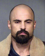 FILE - This undated file booking photo provided by the Maricopa County Sheriff's Office shows Michael Lee Crane of Mesa, Ariz. Crane, convicted in the deaths seven years ago of a cigar salesman in Phoenix and a couple from an upscale suburb, will spend the rest of his life in prison. A judge on Friday, March 22, 2019 handed down a life sentence for each victim for Michael Lee Crane as part of a plea deal in the January 2012 killings of Bruce Gaudet and Lawrence and Glenna Shapiro. (Maricopa County Sheriff's Office via AP, File)