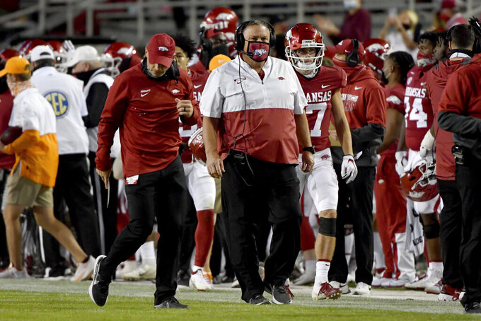 Arkansas coach Sam Pittman walks the sideline during the first half of the team's NCAA college football game against Tennessee on Saturday, Nov. 7, 2020, in Fayetteville, Ark. (AP Photo/Michael Woods)