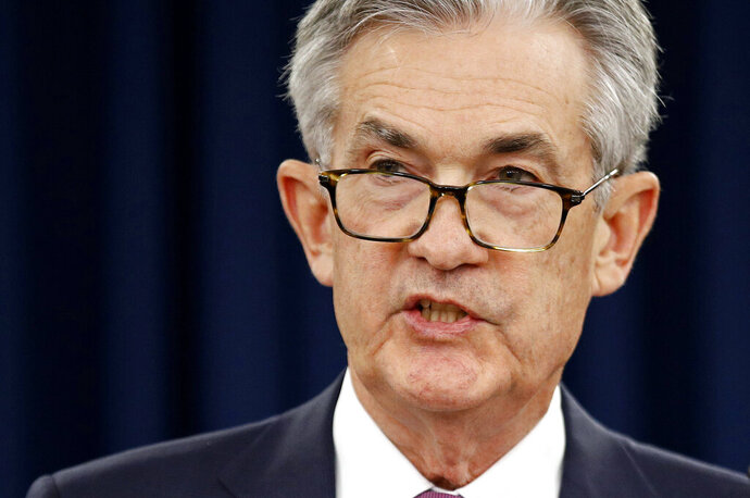 """FILE - In this May 1, 2019 file photo, Federal Reserve Board Chair Jerome Powell speaks at a news conference following a two-day meeting of the Federal Open Market Committee, in Washington. Federal Reserve officials at their recent meeting believed the central bank could remain """"patient"""" in deciding when to adjust interest rates, though some officials thought future rate hikes might still be needed. In minutes of the April 30-May 1 discussions, Fed officials note that prospects for the U.S. and global economy had been improving, while inflation had fallen farther below the Fed's 2% target.  (AP Photo/Patrick Semansky, File)"""