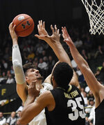 Colorado State center Nico Carvacho, left, shoots as Colorado center Dallas Walton defends in the first half of an NCAA college basketball game in Fort Collins, Colo., Friday, Dec. 13, 2019. (Bethany Baker/Fort Collins Coloradoan via AP)
