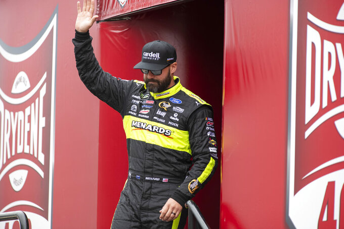 Paul Menard (21) walks on to the stage during driver introductions at the Drydene 400 - Monster Energy NASCAR Cup Series playoff auto race, Sunday, Oct. 6, 2019, at Dover International Speedway in Dover, Del. (AP Photo/Jason Minto)