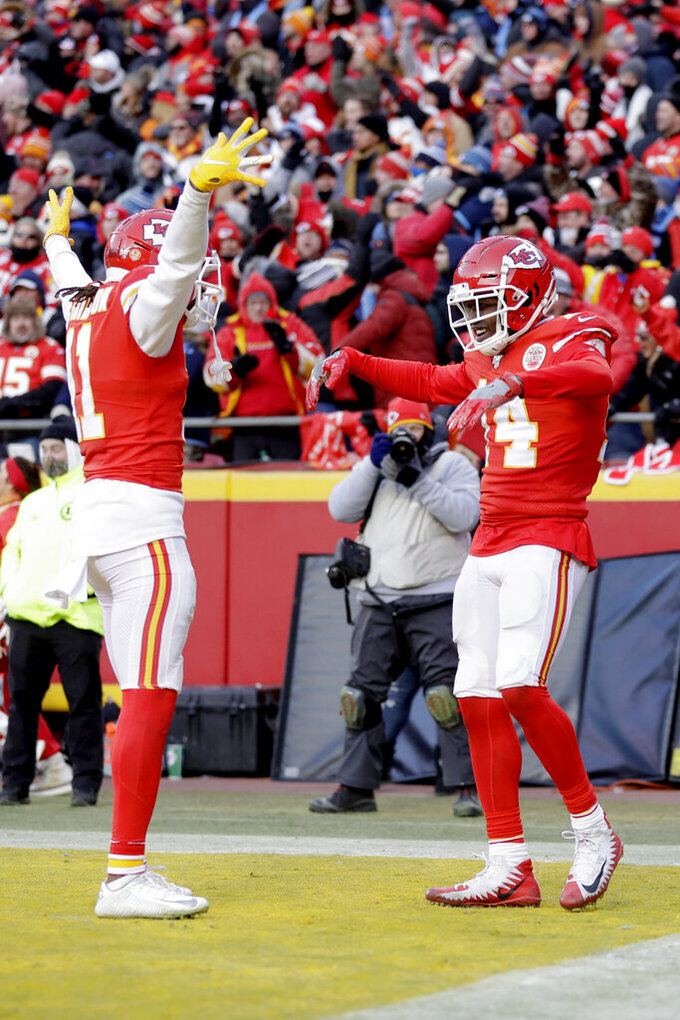 Kansas City Chiefs' Sammy Watkins, right, celebrates with Demarcus Robinson (11) after catching a touchdown pass during the second half of the NFL AFC Championship football game against the Tennessee Titans Sunday, Jan. 19, 2020, in Kansas City, MO. (AP Photo/Jeff Roberson)