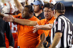 Oklahoma State coach Mike Gundy talks with an official during the second half of the team's NCAA college football game against Missouri State, Saturday, Sept. 4, 2021, in Stillwater, Okla. (AP Photo/Sue Ogrocki)