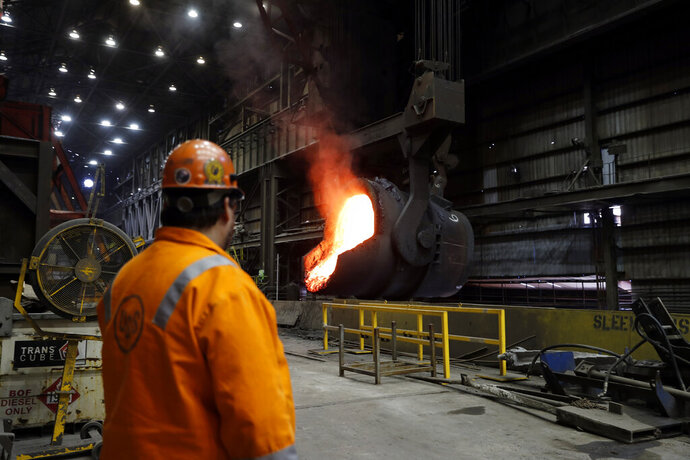 FILE - In this June 28, 2018 photo file, senior melt operator Randy Feltmeyer watches a giant ladle as it backs away after pouring its contents of red-hot iron into a vessel in the basic oxygen furnace as part of the process of producing steel at the U.S. Steel Granite City Works facility in Granite City, Ill. President Donald Trump's decision last year to tax imported steel tested the limits of his legal authority, strained relations with key U.S. allies and imposed higher costs and uncertainty on much of American industry. But his 25% tariffs haven't even done much for the companies they were supposed to help.  (AP Photo/Jeff Roberson, File)
