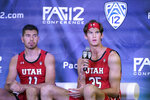 Utah's Branden Carlson, right, speaks to reporters as Riley Battin listens during the Pac-12 men's NCAA college basketball media day Wednesday, Oct. 13, 2021, in San Francisco. (AP Photo/Jeff Chiu)