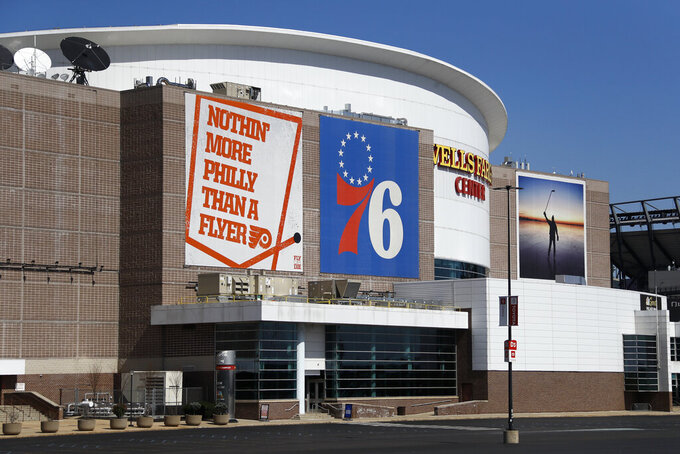 FILE - This is a March 14, 2020, file photo showing the Wells Fargo Center, home of the Philadelphia Flyers NHL hockey team and the Philadelphia 76ers NBA basketball team. The Philadelphia Flyers and 76ers are set to offer refunds or credits for unplayed regular-season games at their shared arena because of the coronavirus pandemic.  While neither the NHL or NBA has officially canceled the remainder of the season, or decided when and where the season may resume, both organizations on Tuesday, May 5, 2020,  decided to address the ticket status for games scheduled for the Wells Fargo Center. (AP Photo/Matt Slocum, File)