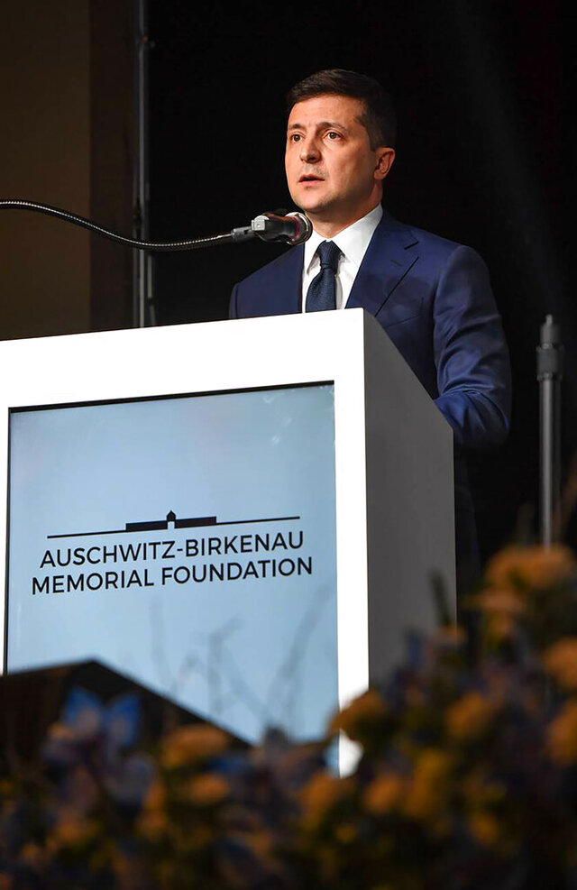 Ukrainian President Volodymyr Zelenskiy speaks at welcome dinner for Holocaust survivors and their families hosted in Krakow, Poland, by the Auschwitz-Birkenau Memorial Foundation, Sunday Jan. 26, 2020. Volodymyr Zelenskiy paid tribute Sunday evening to Holocaust survivors, telling them on the eve of the 75th anniversary of the death camp's liberation that they are an example to humanity. Zelenskiy spoke of the importance of protecting humanitarian values and freedom against the hatred that threatens civilization in a short speech at a dinner in Krakow organized by the World Jewish Congress. (Shahar Azran/WJC via AP)