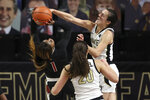 Louisville guard Dana Evans, left, shoots the winning basket against Wake Forest guard Gina Conti (5) in the fourth quarter of an NCAA women's college basketball game in Winston-Salem, N.C., Sunday, Jan. 24, 2021. Louisville won 65-63. (AP Photo/Nell Redmond)